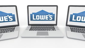 Notebooks with Lowe`s logo on the screen. Computer technology conceptual editorial 3D rendering Stock Photo