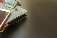 Notebooks and mobile phones, glasses in the desk royalty free stock photography