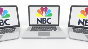 Notebooks with National Broadcasting Company NBC logo on the screen. Computer technology conceptual editorial 3D Royalty Free Stock Image