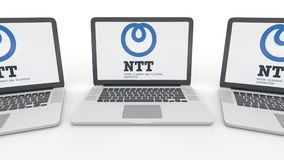 Notebooks with Nippon Telegraph and Telephone Corporation NTT logo on the screen. Computer technology conceptual Stock Photo