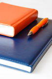 Notebooks and pen Royalty Free Stock Photo