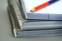 Notebooks and pencil Stock Photo