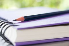 Notebooks and pencil over nature green background stock photos