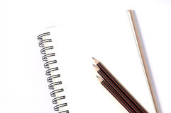 Notebooks and pencil on white background Royalty Free Stock Images