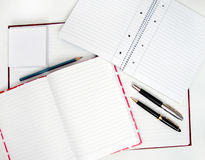 Notebooks and pens Royalty Free Stock Images