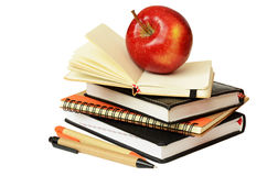 Notebooks, pens and apple Royalty Free Stock Image