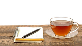Notebooks, pens and glass tea Royalty Free Stock Photos