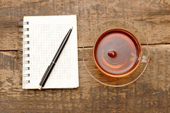 Notebooks, pens and glass tea stock image