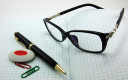 Notebooks, pens, glasses. Are isolated on a white background Royalty Free Stock Photo