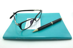 Notebooks, pens, glasses. Are isolated on a white background Royalty Free Stock Photos