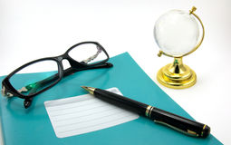 Notebooks, pens, glasses. Are isolated on a white background Stock Photos