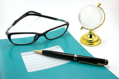 Notebooks, pens, glasses. Are isolated on a white background Stock Images