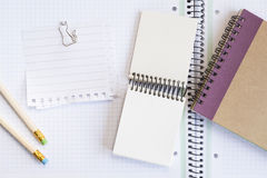 Notebooks with pens and paper Royalty Free Stock Image