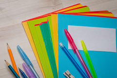 Notebooks and pens. With pencils royalty free stock image