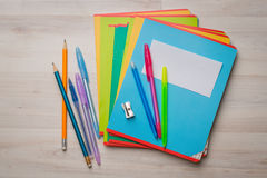 Notebooks and pens Stock Photos