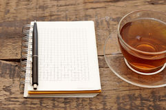 Notebooks, pens, tea Royalty Free Stock Images