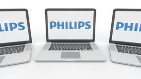 Notebooks with Philips logo on the screen. Computer technology conceptual editorial 3D rendering Royalty Free Stock Image