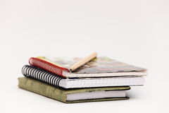 Notebooks for records and a pencil. Notebooks and pencil lay on a table Stock Image