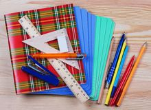 Notebooks,ruler,triangle, pen and pensil Royalty Free Stock Photo
