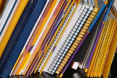 Notebooks on shelf Stock Image