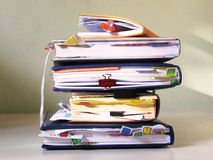 Notebooks with tabs stacked in a pile Stock Photo