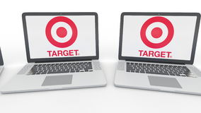 Notebooks with Target Corporation logo on the screen. Computer technology conceptual editorial 4K clip, seamless loop. Notebooks with Target Corporation logo on stock video