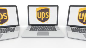 Notebooks with United Parcel Service UPS logo on the screen. Computer technology conceptual editorial 3D rendering Royalty Free Stock Photography