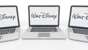 Notebooks with Walt Disney Pictures logo on the screen. Computer technology conceptual editorial 3D rendering Stock Images