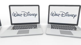 Notebooks with Walt Disney Pictures logo on the screen. Computer technology conceptual editorial 4K clip, seamless loop. Notebooks with Walt Disney Pictures logo vector illustration