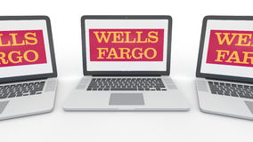 Notebooks with Wells Fargo logo on the screen. Computer technology conceptual editorial 3D rendering. Notebooks with Wells Fargo logo on the screen. Computer Royalty Free Stock Photography