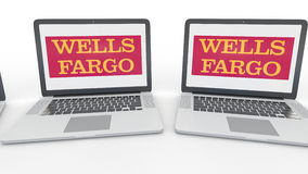 Notebooks with Wells Fargo logo on the screen. Computer technology conceptual editorial 4K clip, seamless loop. Notebooks with Wells Fargo logo on the screen stock video footage