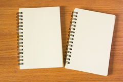 Notebooks on wood table Stock Images