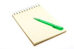 Notepad 1. Note pad and green pencil white background Royalty Free Stock Photos