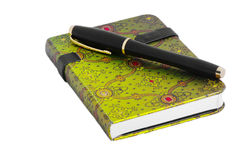 Notepad. With arabic green ornament and pen on the white table Stock Image