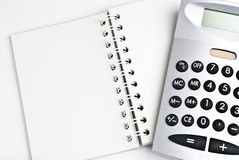 Notepad. Calculator with a notepad isolated on a white background Royalty Free Stock Photos