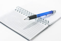 Notepad. A notepad and a pen isolated on a white background Stock Images
