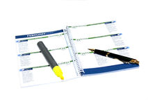 Notepad. A calendar note pat with a pen and an marker over white Stock Photography