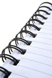 Notepad 22. Close up of wire bound notebook on white background royalty free stock photo