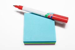 Notepad #3. Red fiber tipped pen and sticky pad stock photos