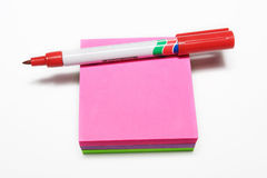 Notepad #5. Red fiber tipped pen and sticky pad royalty free stock photo