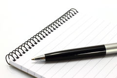 Notepad with ball pen Stock Photography