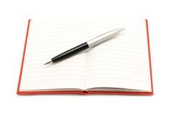 Notepad with ball pen Stock Photos
