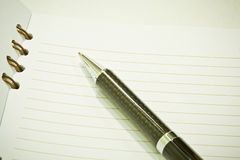 Notepad and ball pen Royalty Free Stock Photography