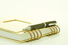 Notepad and ball pen Royalty Free Stock Image