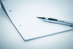 Notepad and ballpen. An image of a notepad and a ballpen Stock Photo