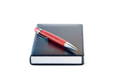 Notepad with ballpoint  pen Royalty Free Stock Photo