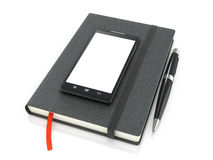 Notepad with ballpoint pen and smartphone Royalty Free Stock Image