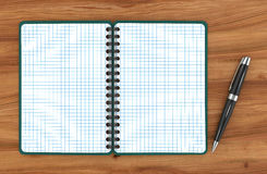 Notepad with a ballpoint pen Royalty Free Stock Photography