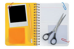 Notepad and black instant photo Stock Photos
