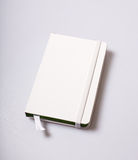 Notepad blank cover on white table Royalty Free Stock Photography